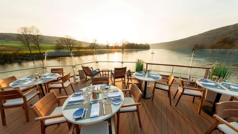 Viking river cruises Longship Aquavit restaurant at sunset